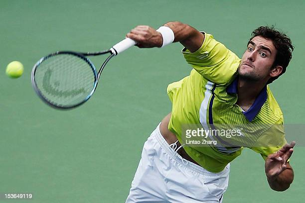 Marin Cilic of Croatia hits a serve to Lukasz Kubot of Poland during the day two of Shanghai Rolex Masters at the Qi Zhong Tennis Center on October...