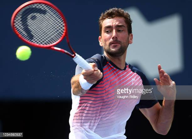 Marin Cilic of Croatia hits a shot against Albert Ramos-Vinolas of Spain during the first round on Day One of the National Bank Open at Aviva Centre...