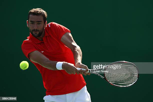 Marin Cilic of Croatia in action against Grigor Dimitrov of Bulgaria in the men's first round on Day 1 of the Rio 2016 Olympic Games at the Olympic...