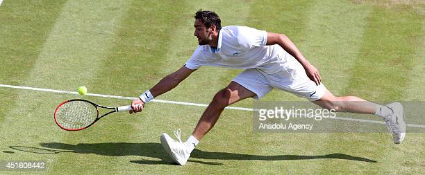 Marin Cilic of Croatia in action during his Gentlemen's Singles quarterfinal match against Novak Djokovic of Serbia on day nine of the Wimbledon...
