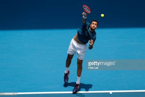 Marin Cilic of Croatia in action during his Men's Singles fourth round match against Milos Raonic of Canada on day seven of the 2020 Australian Open...