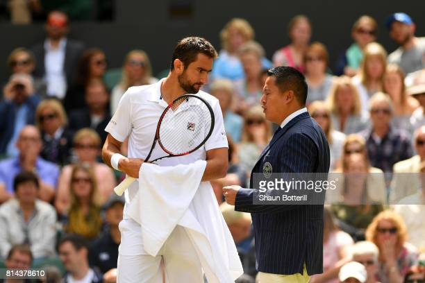 Marin Cilic of Croatia in discussion with chair umpire James Keothavong during the Gentlemen's Singles semi final match against Sam Querrey of The...