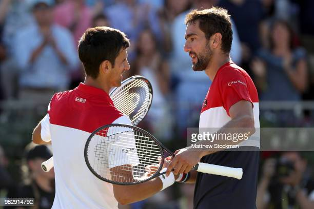 Marin Cilic of Croatia is congratulated after his men's singles final match by Novak Djokovic of Serbia on Day Seven of the FeverTree Championships...