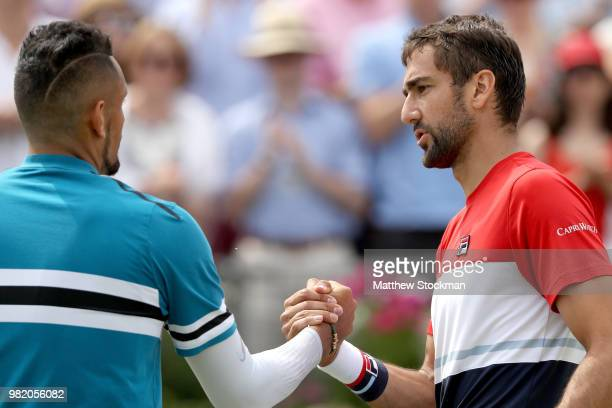 Marin Cilic of Croatia is congratulated after his men's singles semifinal match by Nick Kyrgios of Australia on Day Six of the FeverTree...