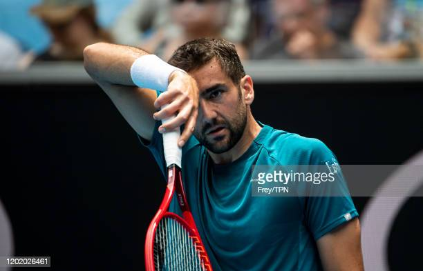Marin Cilic of Croatia looks frustrated in his fourth round match against Milos Raonic of Canada on day seven of the 2020 Australian Open at...