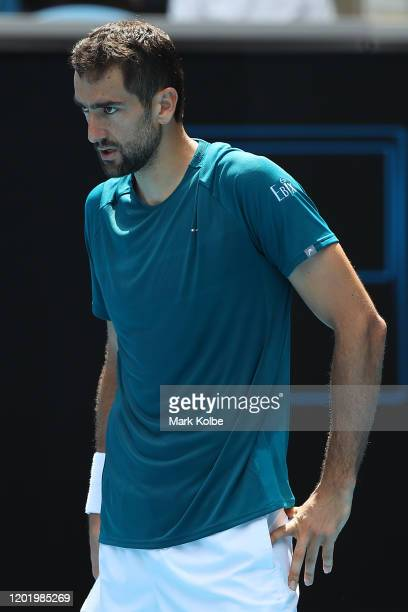Marin Cilic of Croatia looks on during his Men's Singles fourth round match against Milos Raonic of Canada on day seven of the 2020 Australian Open...