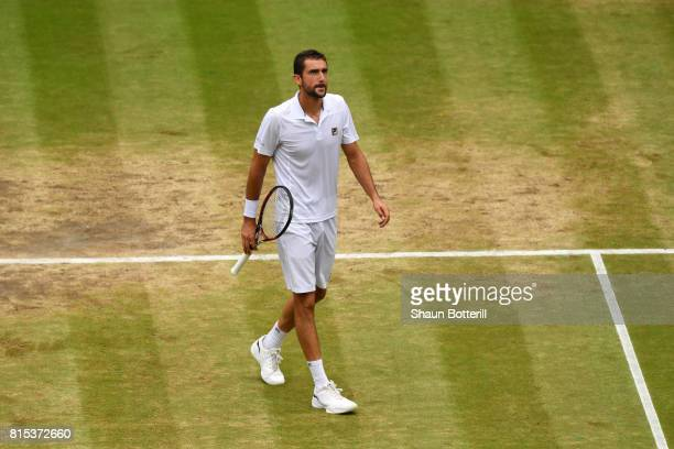 Marin Cilic of Croatia looks thoughtful during the Gentlemen's Singles final against Roger Federer of Switzerland on day thirteen of the Wimbledon...