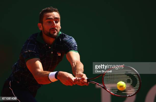 Marin Cilic of Croatia plays a backhand against Albert RamosVinolas of Spain in their quarter final round match on day six of the Monte Carlo Rolex...