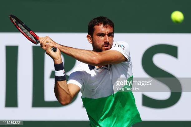 Marin Cilic of Croatia plays a backhand against Denis Shapovalov of Canada during their men's singles third round match on Day 9 of the BNP Paribas...