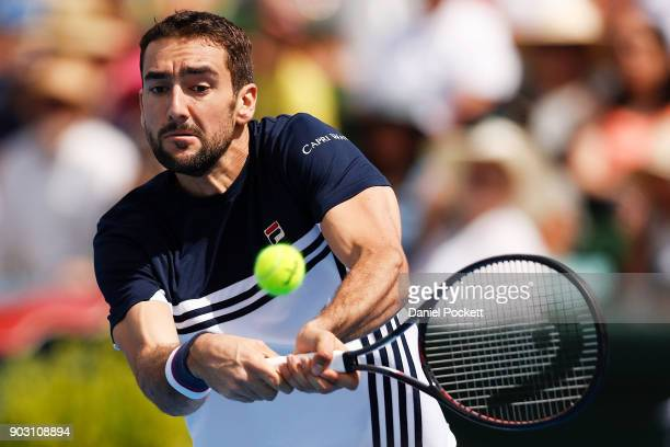 Marin Cilic of Croatia plays a backhand against Matt Ebden of Australia during the 2018 Kooyong Classic at Kooyong on January 10 2018 in Melbourne...