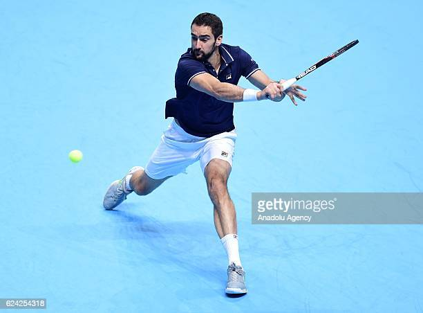 Marin Cilic of Croatia plays a backhand during his Men's Singles match against Kei Nishikori of Japan during day six of the Barclays ATP World Tour...
