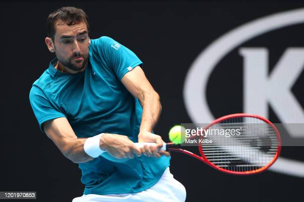 Marin Cilic of Croatia plays a backhand during his Men's Singles fourth round match against Milos Raonic of Canada on day seven of the 2020...