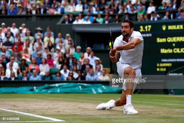 Marin Cilic of Croatia plays a backhand during the Gentlemen's Singles semi final match against Sam Querrey of The United States on day eleven of the...