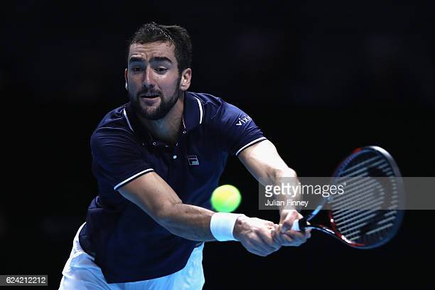 Marin Cilic of Croatia plays a backhand during the men's singles match against Kei Nishikori of Japan on day six of the ATP World Tour Finals at O2...