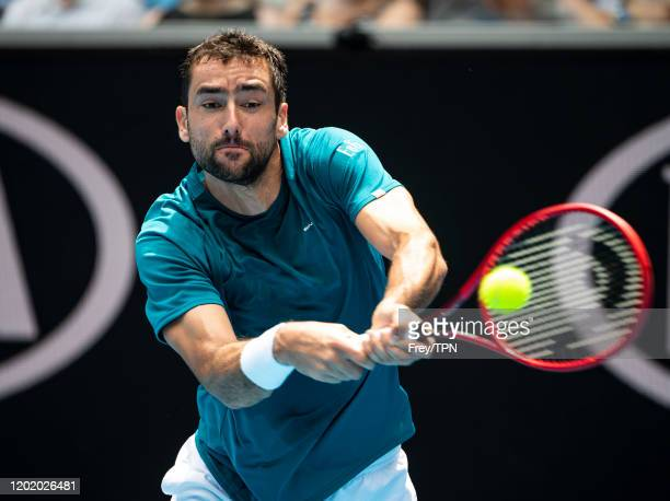 Marin Cilic of Croatia plays a backhand in his fourth round match against Milos Raonic of Canada on day seven of the 2020 Australian Open at...