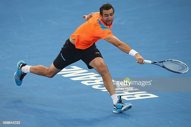 Marin Cilic of Croatia plays a backhand in his match against Grigor Dimitrov of Bulgaria during day four of the 2014 Brisbane International at...