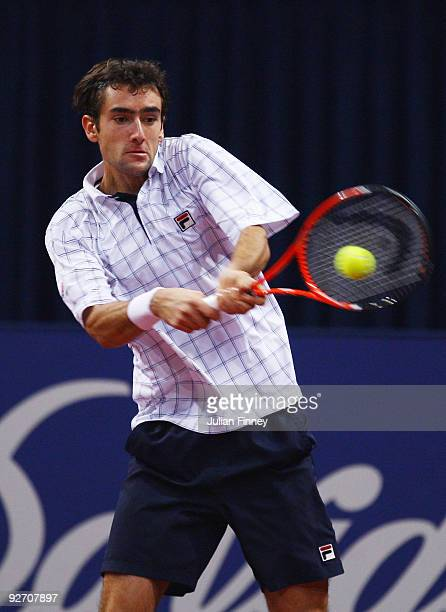Marin Cilic of Croatia plays a backhand in his match against Philipp Petzschner of Germany during Day Three of the Davidoff Swiss Indoors Tennis at...