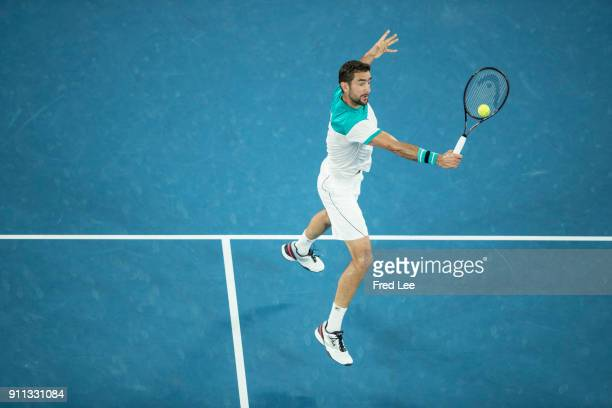 Marin Cilic of Croatia plays a backhand in his men's singles final match against Roger Federer of Switzerland on day 14 of the 2018 Australian Open...