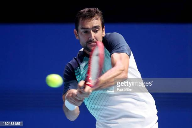 Marin Cilic of Croatia plays a backhand in his Men's Singles Semifinals match against Alexei Popyrin of Australia on day six of the Singapore Tennis...
