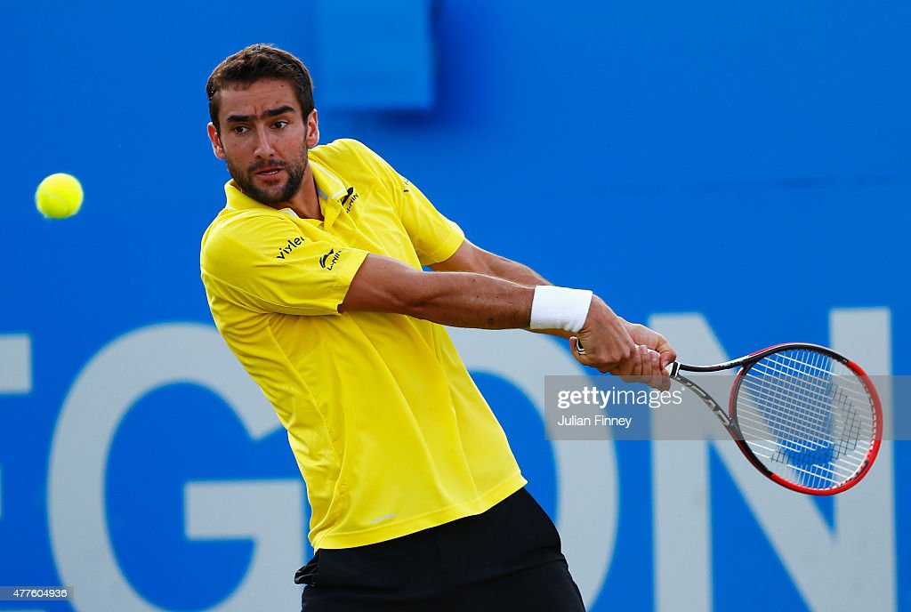 Marin Cilic of Croatia plays a backhand in his men's singles second round match against Viktor Troicki of Serbia during day four of the Aegon Championships at Queen's Club on June 18, 2015 in London, England.