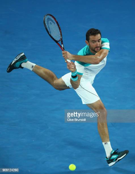 Marin Cilic of Croatia plays a backhand in his quarterfinal match against Rafael Nadal of Spain on day nine of the 2018 Australian Open at Melbourne...