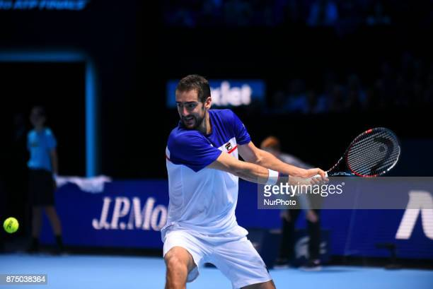 Marin Cilic of Croatia plays a backhand in his Singles match against Roger Federer of Switzerland during day five of the Nitto ATP World Tour Finals...