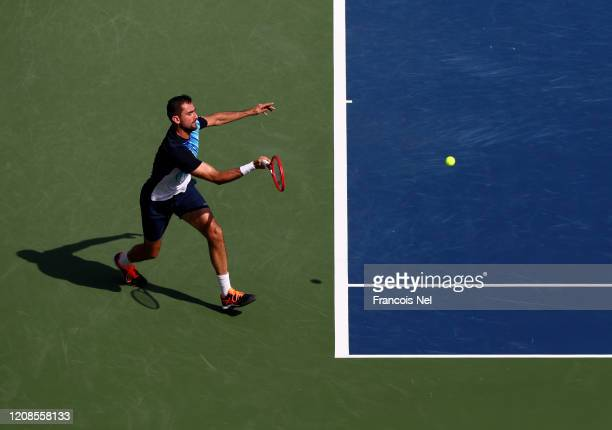 Marin Cilic of Croatia plays a forehand against Benoit Paire of France during his men's singles match on Day Nine of the Dubai Duty Free Tennis at...