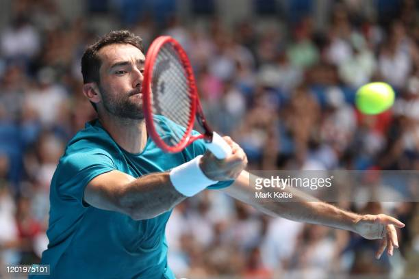 Marin Cilic of Croatia plays a forehand during his Men's Singles fourth round match against Milos Raonic of Canada on day seven of the 2020...
