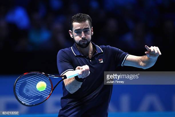 Marin Cilic of Croatia plays a forehand during the men's singles match against Kei Nishikori of Japan on day six of the ATP World Tour Finals at O2...