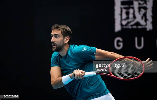Marin Cilic of Croatia plays a forehand in his fourth round match against Milos Raonic of Canada on day seven of the 2020 Australian Open at...