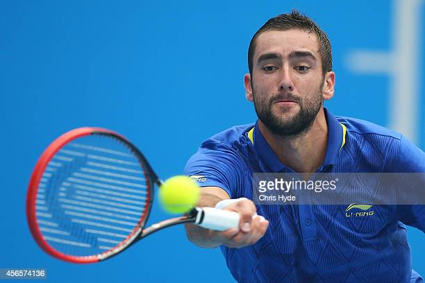 Marin Cilic of Croatia plays a forehand in his match against Andy Murray of Great Britain during day seven of the China Open at the National Tennis...