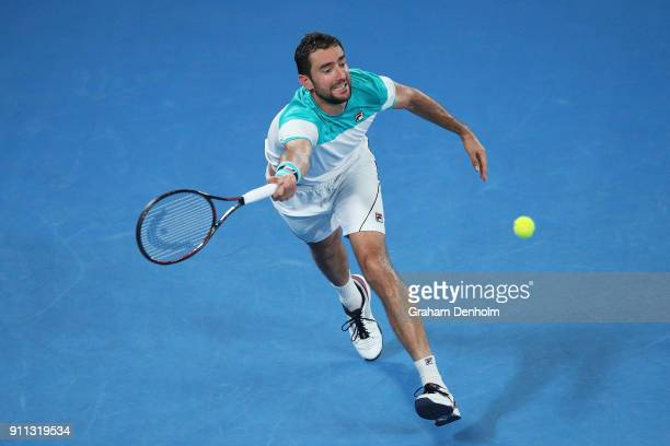 Marin Cilic of Croatia plays a forehand in his men's singles final match against Roger Federer of Switzerland on day 14 of the 2018 Australian Open...