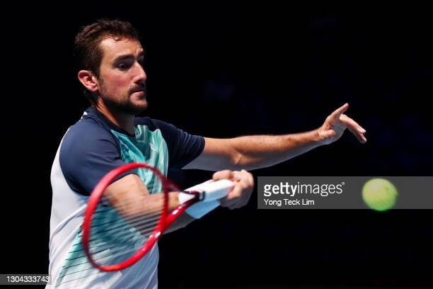 Marin Cilic of Croatia plays a forehand in his Men's Singles Semifinal match against Alexei Popyrin of Australia on day six of the Singapore Tennis...