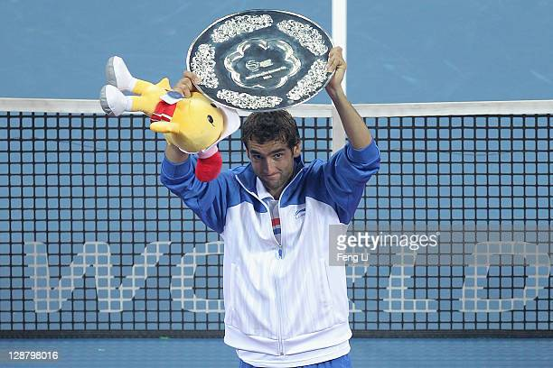 Marin Cilic of Croatia pose for photographers after winning the second place of the men's final in the China Open at the National Tennis Center on...
