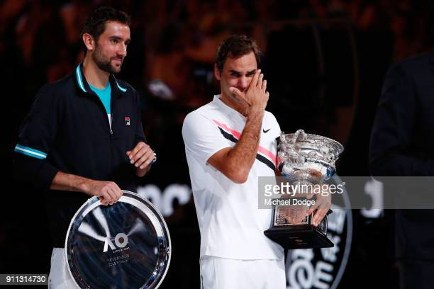 Marin Cilic of Croatia poses with the runnersup trophy and an emotioinal Roger Federer of Switzerland poses with the Norman Brookes Challenge Cup...