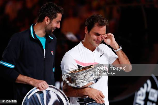Marin Cilic of Croatia poses with the runnersup trophy and an emotional Roger Federer of Switzerland poses with the Norman Brookes Challenge Cup...
