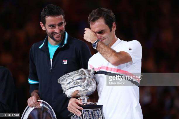 Marin Cilic of Croatia poses with the runnersup trophy and Roger Federer of Switzerland poses with the Norman Brookes Challenge Cup after winning the...
