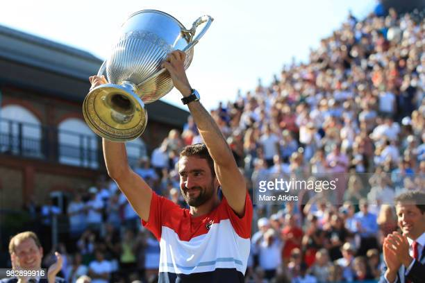 Marin Cilic of Croatia poses with the trophy after his win over Novak Djokovic of Serbia during Day 7 of the FeverTree Championships at Queens Club...