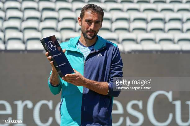 Marin Cilic of Croatia poses with trophy after winning the MercedesCup against Felix Auger-Aliassime of Canada during day 7 of the MercedesCup at...