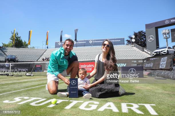 Marin Cilic of Croatia poses with trophy and his family after winning the MercedesCup against Felix Auger-Aliassime of Canada during day 7 of the...