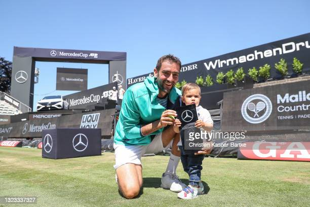 Marin Cilic of Croatia poses with trophy and his son after winning the MercedesCup against Felix Auger-Aliassime of Canada during day 7 of the...