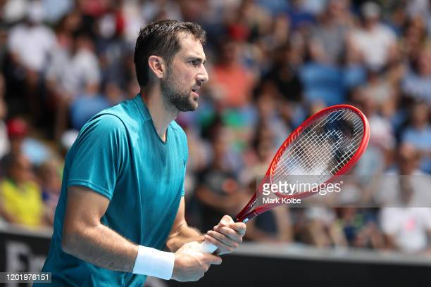 Marin Cilic of Croatia prepares to return a serve during his Men's Singles fourth round match against Milos Raonic of Canada on day seven of the 2020...