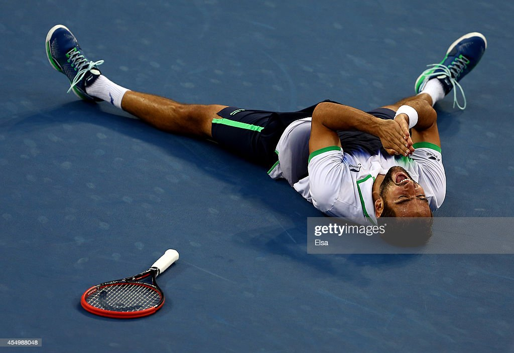 Marin Cilic of Croatia reacts after defeating Kei Nishikori of Japan to win the men's singles final match on Day fifteen of the 2014 US Open at the USTA Billie Jean King National Tennis Center on September 8, 2014 in the Flushing neighborhood of the Queens borough of New York City. Cilic defeated Nishikori by a score of 6-3, 6-3, 6-3.