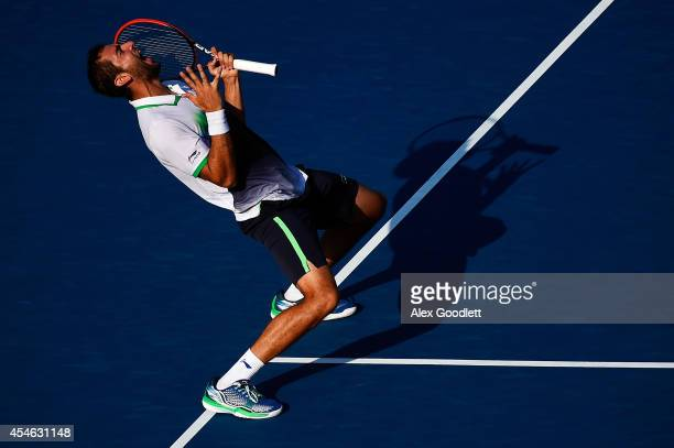 Marin Cilic of Croatia reacts after defeating Tomas Berdych of the Czech Republic during their men's singles quarterfinal match on Day Eleven of the...
