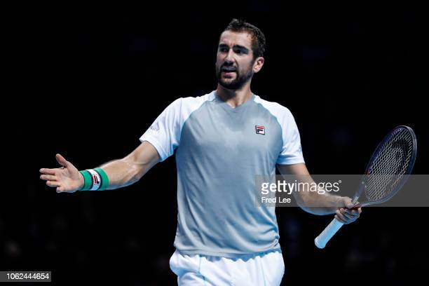 Marin Cilic of Croatia reacts during in his third singles round robin match against Novak Djokovic of Serbia during Day Six of the Nitto ATP Finals...