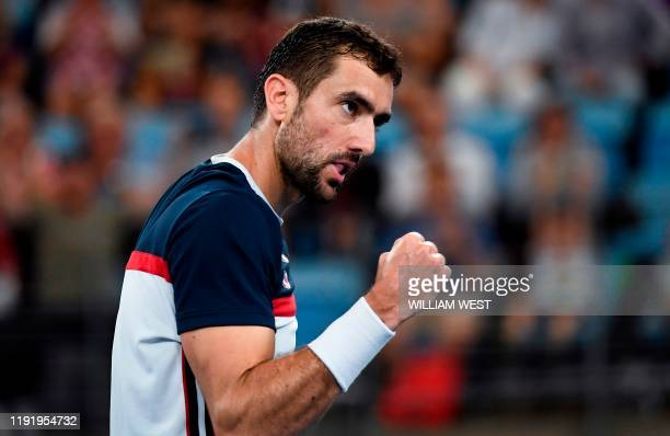 Marin Cilic of Croatia reacts in his men's singles match against Kacper Zuk of Poland at the ATP Cup tennis tournament in Sydney on January 6 2020 /...
