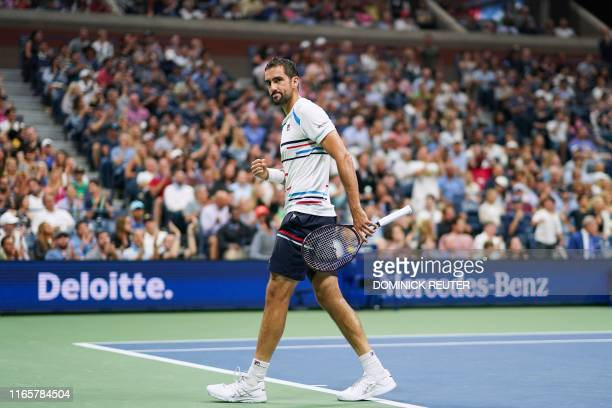 Marin Cilic of Croatia reacts to his point against Rafael Nadal of Spain in their Round Four Men's Singles tennis match during the 2019 US Open at...