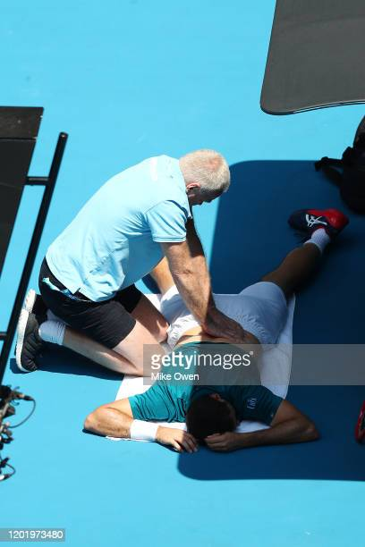 Marin Cilic of Croatia receives medical treatment during his Men's Singles fourth round match against Milos Raonic of Canada on day seven of the 2020...