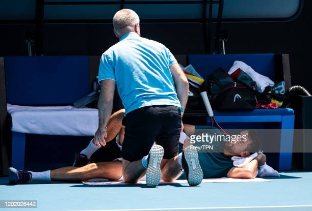 Marin Cilic of Croatia receives treatment for an injury in his fourth round match against Milos Raonic of Canada on day seven of the 2020 Australian...
