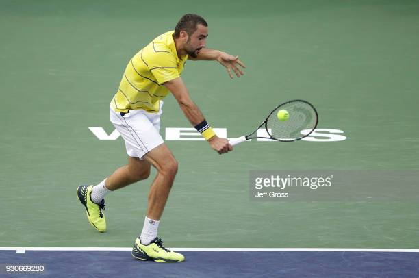 Marin Cilic of Croatia returns a backhand to Marton Fucsovics of Hungary during the BNP Paribas Open on March 11 2018 at the Indian Wells Tennis...